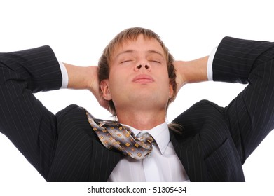 Young businessman has rest in armchair, isolated on white background.