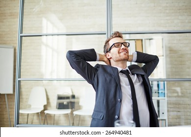 Young businessman having a little rest after work in office