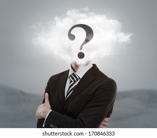 Young businessman with head in the clouds and question mark