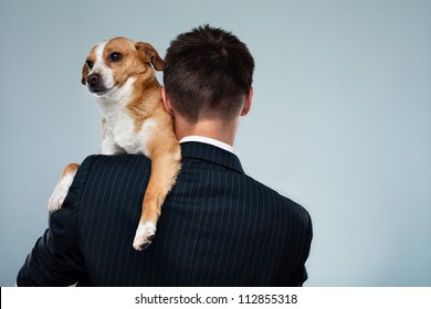 Young businessman with his dog on his shoulder
