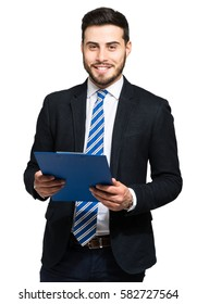 Young businessman holding a clipboard isolated on white