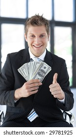 Young Businessman holding dollars in his hands