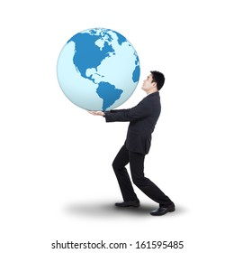Young businessman holding the earth planet