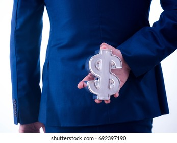 Young businessman holding a financial symbol on the back isolated on white background.