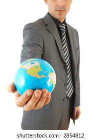 young businessman holding globe, on white background