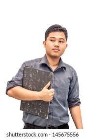 Young businessman holding grey file folder