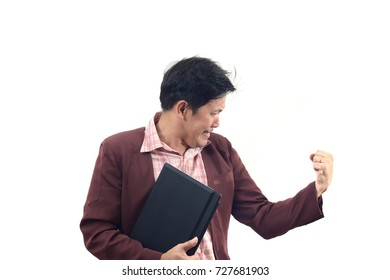 young businessman holding laptop and celebrating in cheerful and success emotion isolate on a white background