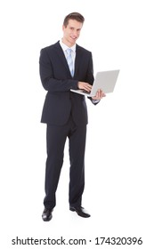 Young Businessman Holding Laptop Over White Background