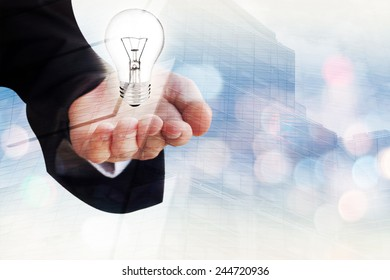 Young businessman holding a light bulb in his hand