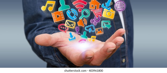 Young businessman holding modern digital icon application in his hand