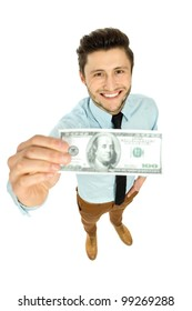 Young businessman holding money