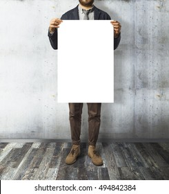Young businessman holding paper