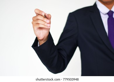 Young businessman holding a pen on a white background, About business and targeting success. (selective focus,out of focus)