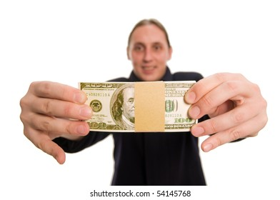 Young businessman holding stack of us dollars, focus on money