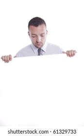 Young businessman holding white board, isolated on white