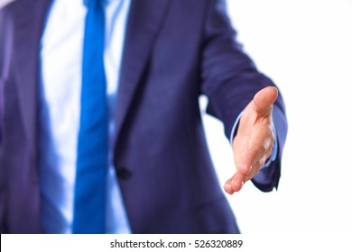 young businessman holds out his hand with a business card for love