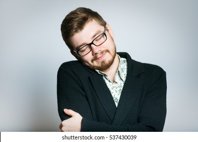 young businessman hugging himself, stylish wear glasses, close-up manager