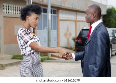Young businessman introducing  himself   at a young businesswoman near her home