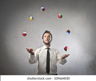 Young businessman juggling