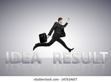 young businessman jumping  from idea to result