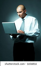 A Young businessman with laptop computer