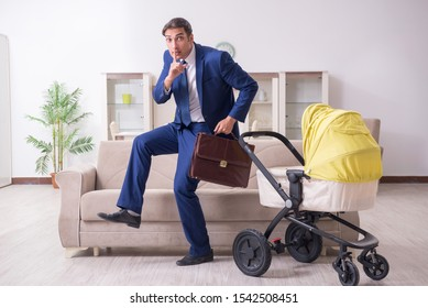 Young businessman looking after baby