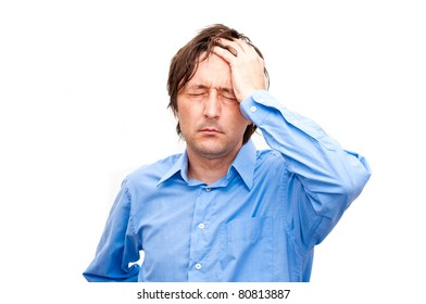 Young businessman looking anxious and worried, having a headache