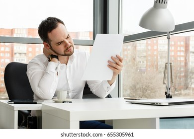 Young businessman looking at documents