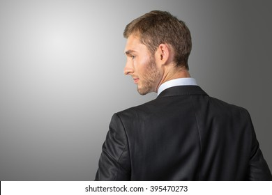 Young Businessman looking over his shoulder
