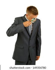 Young businessman looking through magnifying glass isolated on white