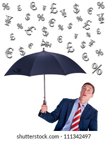 Young businessman looking up from under umbrella and expecting yield