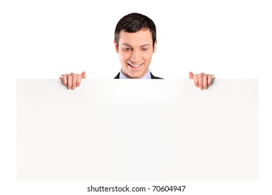 Young businessman looking at white banner isolated on white background
