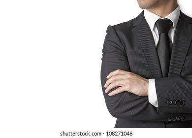 Young businessman looks away on white background