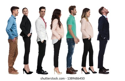 young businessman looks up while standing in line with other people on white background