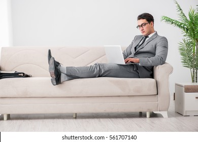 Young businessman lying on the sofa