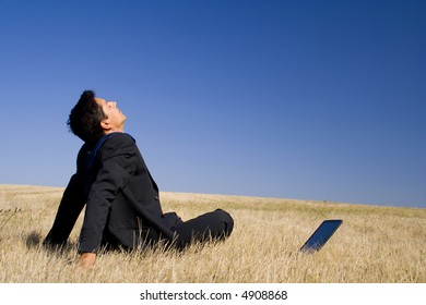 young businessman making peace with nature