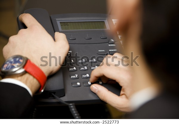 young businessman making a phonecall in his office
