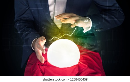 Young businessman making predictions of the future of the stock market with a magic ball