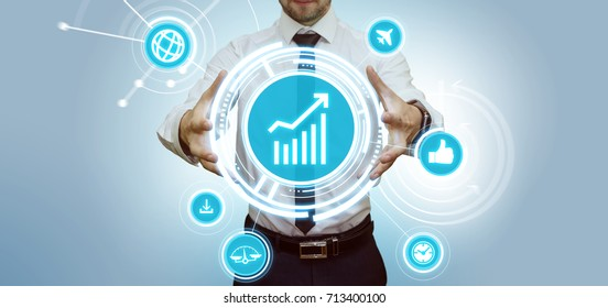 Young businessman making presentation touching virtual panel with media and financial graphs. Modern business and technology concept.
