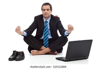 Young businessman meditating - stress control concept
