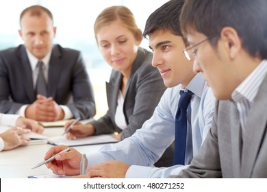 Young businessman at a meeting among his colleagues