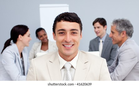Young businessman in a meeting smiling in a meeting