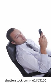 Young businessman with mobile phone, sitting, isolated on white