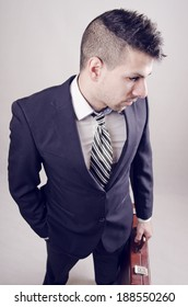 Young businessman with modern hairstyle posing in wide angle portrait