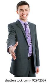 Young businessman offering a handshake