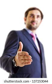 Young businessman offering his hand,isolated on white