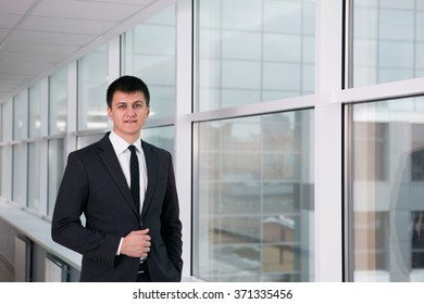 young businessman in an office in a good mood