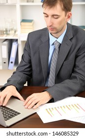 Young businessman in office at his workplace