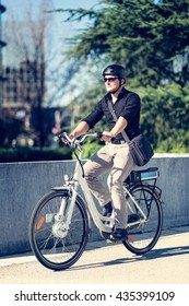 Young businessman on electric bicycle