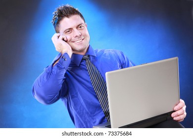 Young businessman  on the phone and online